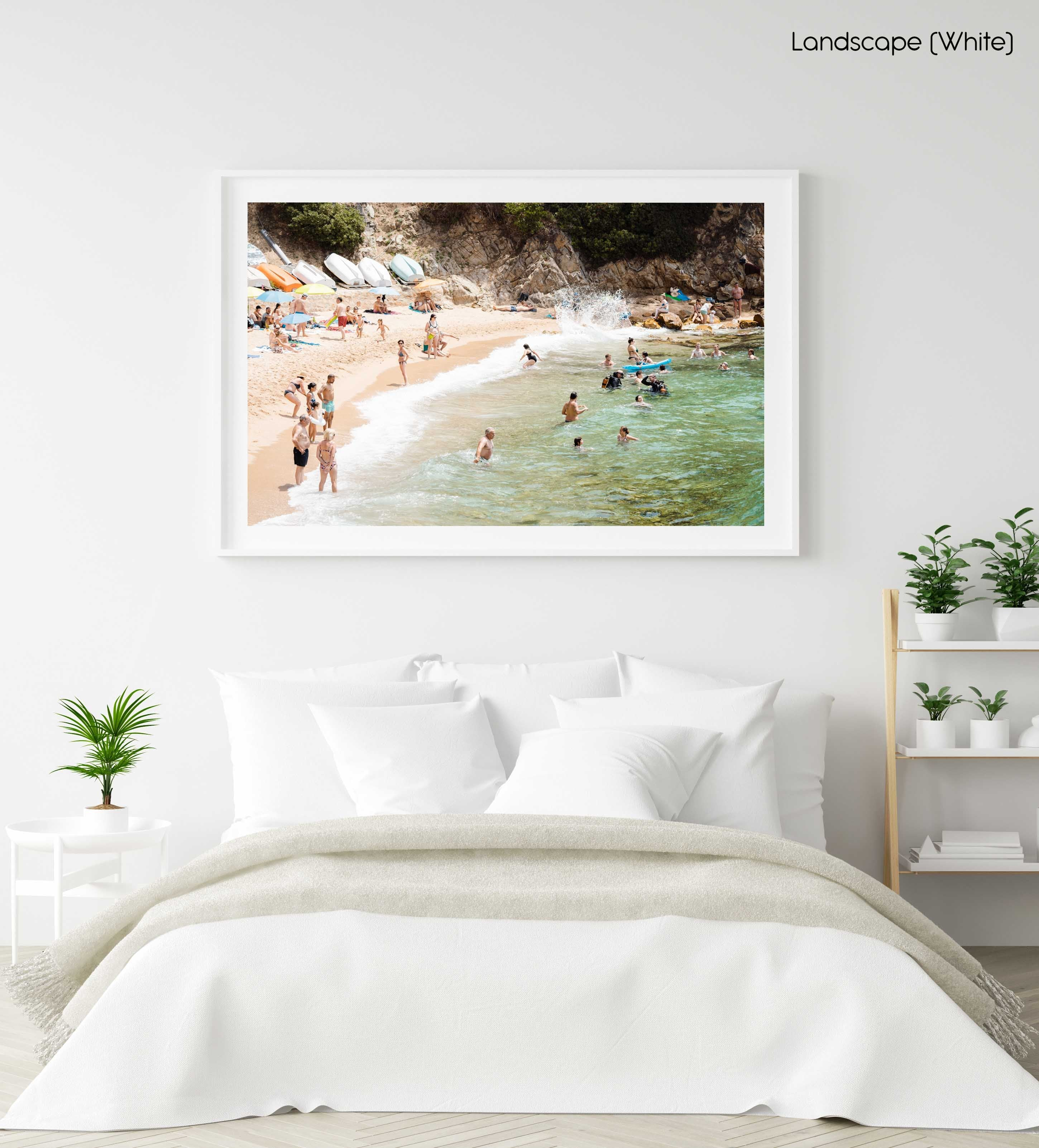 Swimmers, divers and people lying at beach with green water and colorful boats in a white fine art frame