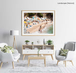 Colorful boats, umbrellas and people lying on beach in a natural fine art frame