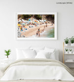 Colorful boats, umbrellas and people lying on beach in a white fine art frame