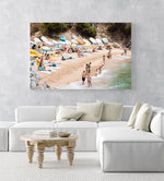Colorful boats, umbrellas and people lying on beach in an acrylic/perspex frame