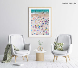 Very crowded Lloret de Mar beach from above with blue water, colorful towels and umbrellas in a natural fine art frame