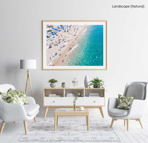 People swimming and having fun in blue water of Lloret de Mar in a natural fine art frame