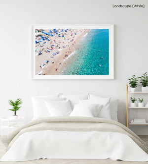 People swimming and having fun in blue water of Lloret de Mar in a white fine art frame