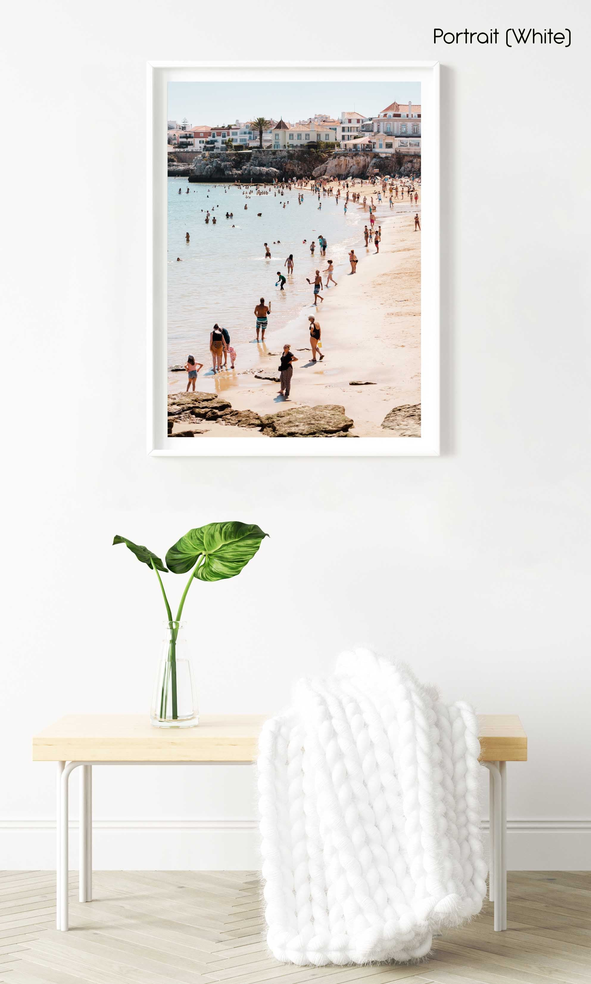 Lots of people along the water and beach in Cascais in a white fine art frame