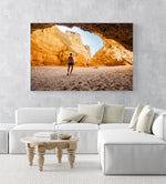 Man walking in a big yellow cave in Praia Dona Ana beach in Lagos in an acrylic/perspex frame
