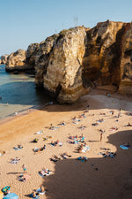 Shadows, cliffs and people on Praia Dona Ana in Lagos from above