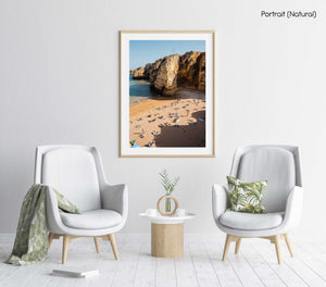 Shadows, cliffs and people on Praia Dona Ana in Lagos from above in a natural fine art frame