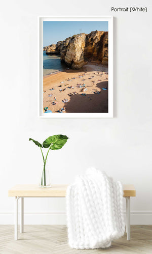 Shadows, cliffs and people on Praia Dona Ana in Lagos from above in a white fine art frame