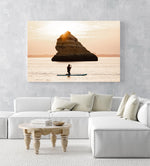 Orange sunrise with woman paddling on a SUP near a big rock in Lagos in an acrylic/perspex frame