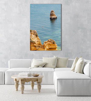 Woman on a SUP in the ocean along Lagos blue water and cliffs in an acrylic/perspex frame