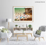 Crowd of people lying with umbrellas and swimming in green sea on Camilo beach in a natural fine art frame