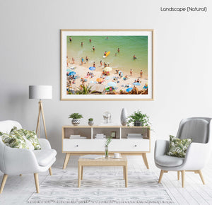 Colorful boards, people, water and sand on Praia do Camilo Lagos in a natural fine art frame