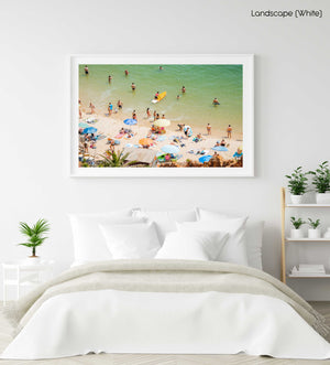 Colorful boards, people, water and sand on Praia do Camilo Lagos in a white fine art frame