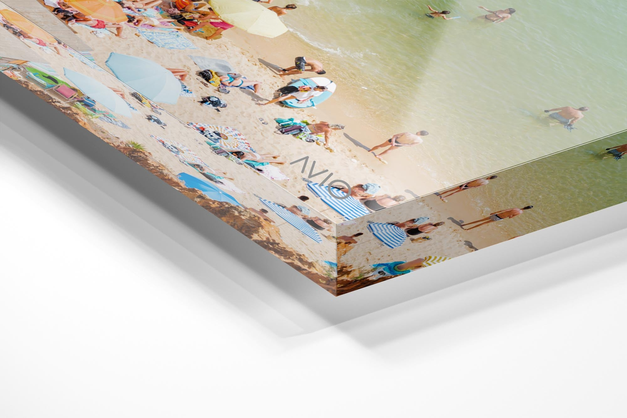 Colorful boards, people, water and sand on Praia do Camilo Lagos in an acrylic/perspex frame