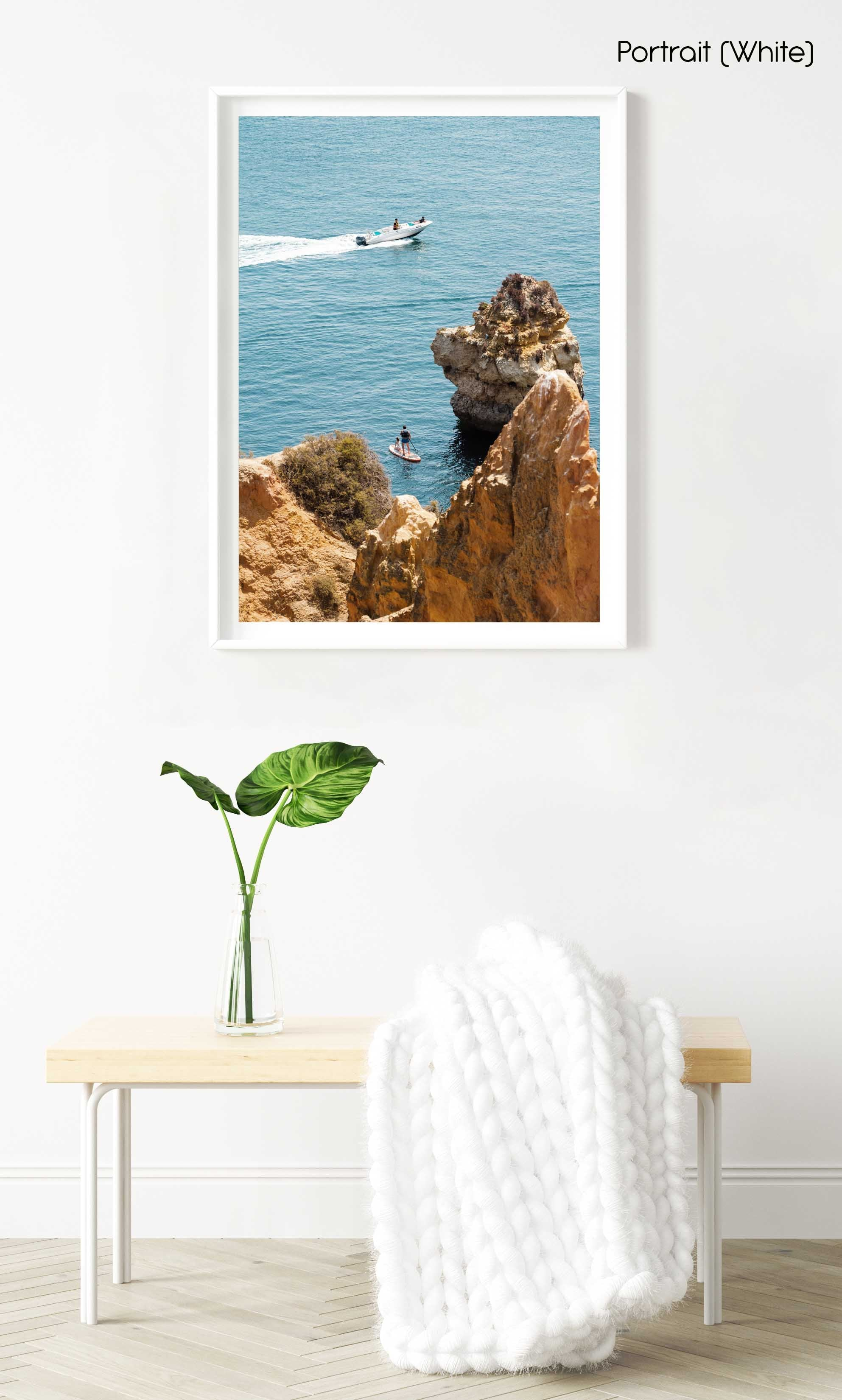 Two people on SUP watching boat drive past Lagos cliffs in a white fine art frame