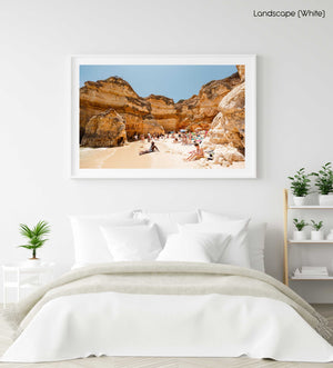 High cliffs overhanging beach where people lying under in June in a white fine art frame