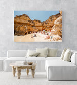 High cliffs overhanging beach where people lying under in June in an acrylic/perspex frame