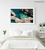 Aerial of two people paddling yellow kayak near Lagos caves in ocean in a white fine art frame