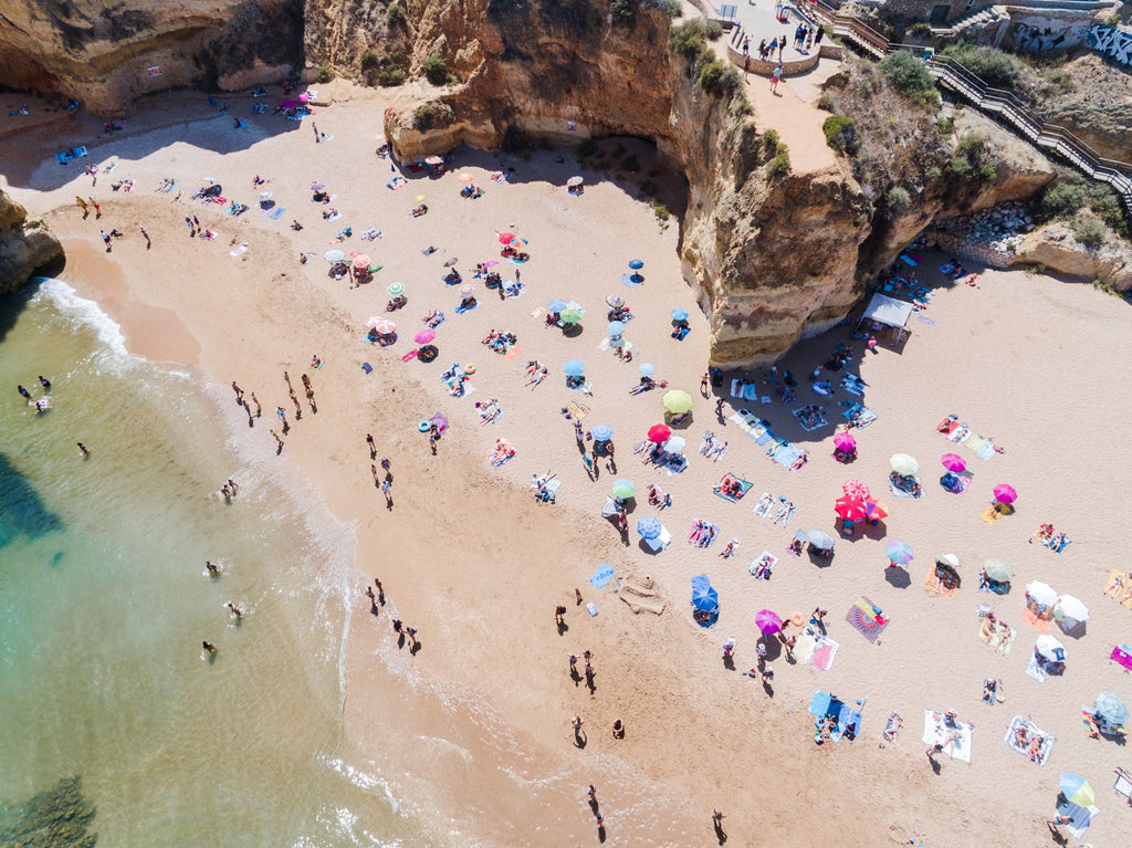 Aerial view of Praia Dona Ana and people tanning