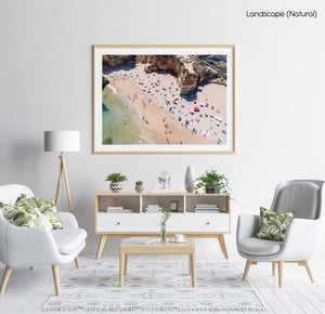 Aerial view of Praia Dona Ana and people tanning in a natural fine art frame