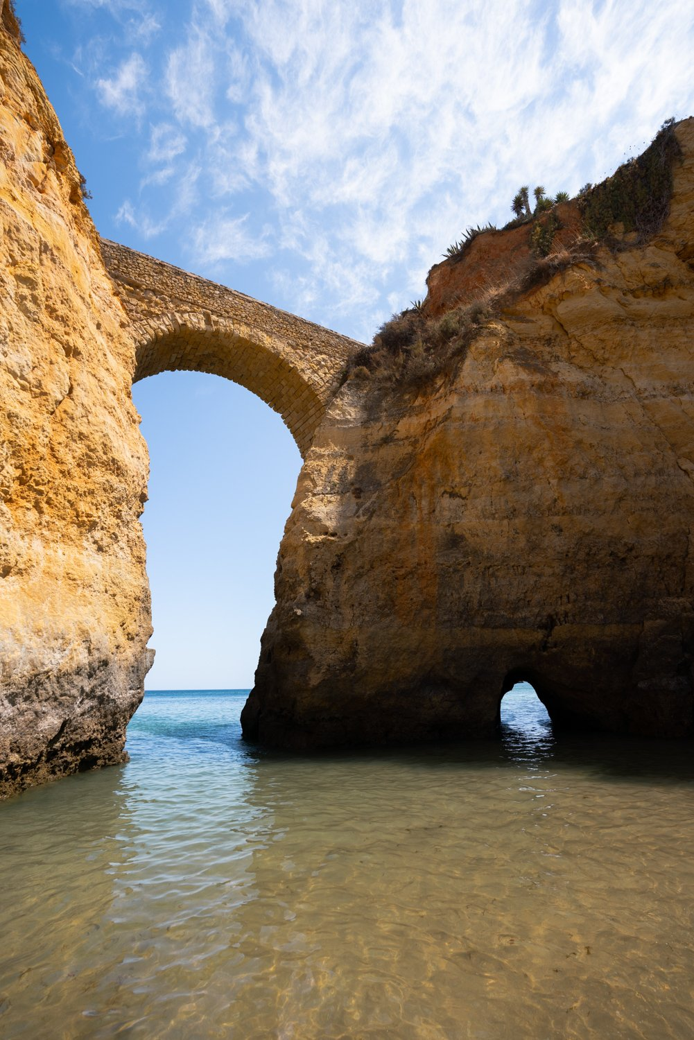 Big arch connecting cliffs along Lagos coast