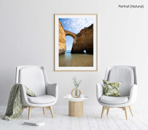 Big arch connecting cliffs along Lagos coast in a natural fine art frame