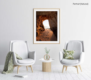 Golden orange light and footsteps through cave at Lagos in a natural fine art frame