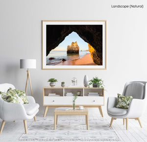 Inside a cave looking at cliffs along beach in Lagos in a natural fine art frame