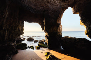 Sunrise light shining through caves in Lagos