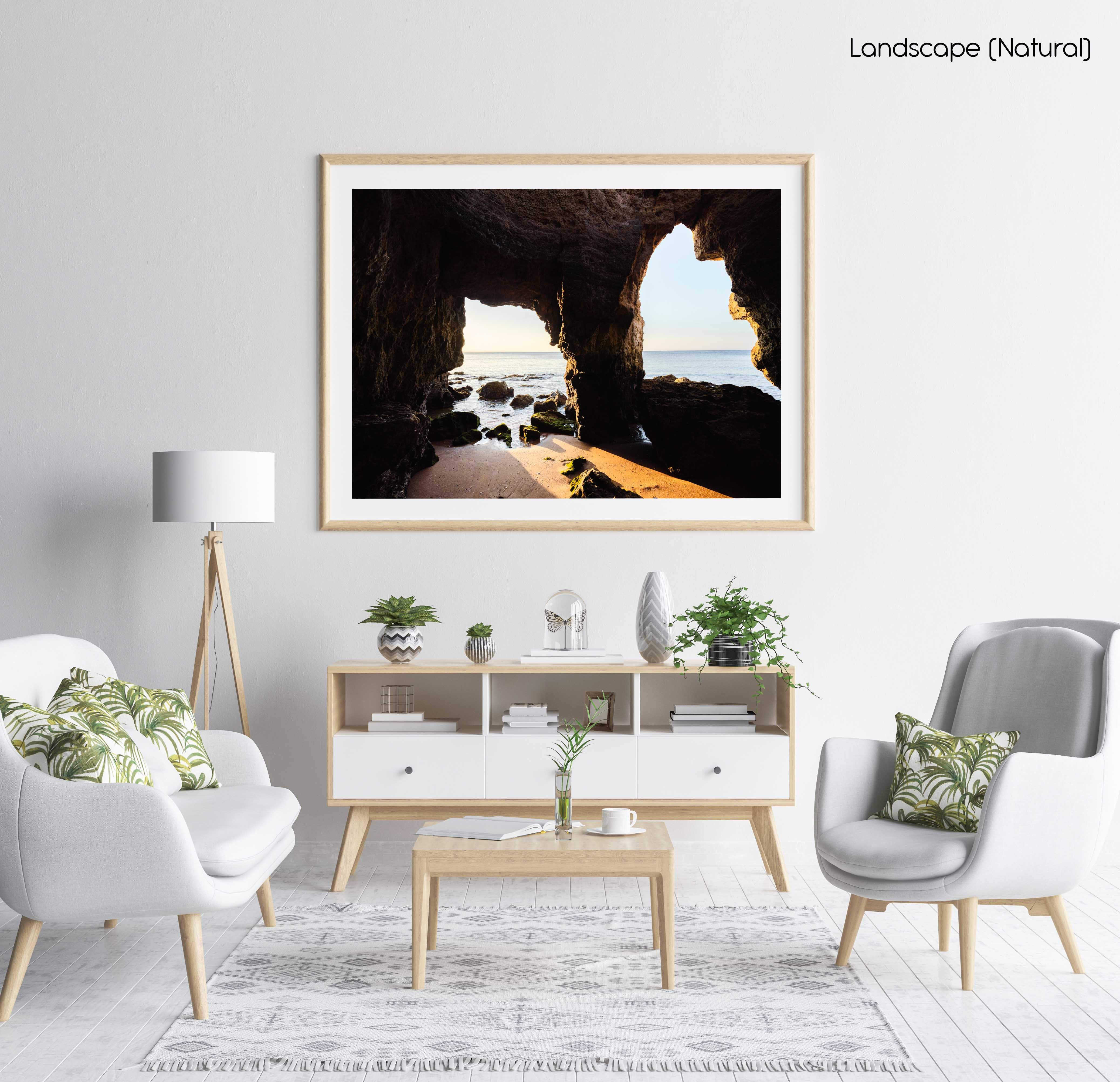 Sunrise light shining through caves in Lagos in a natural fine art frame