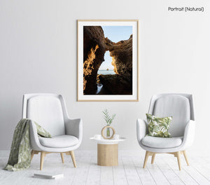 Inside a cave in Lagos looking out to blue sea and rock in a natural fine art frame
