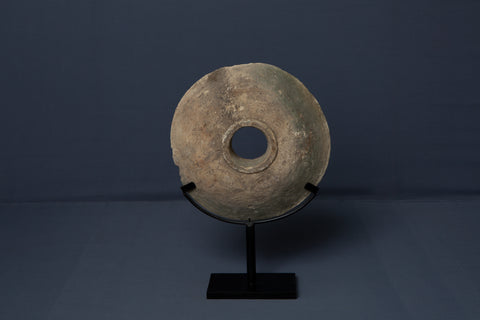Limestone Wedding Disk from Borneo Mounted on an Iron Base