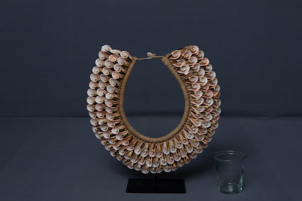 Pink Cut Shell Papua Necklace on a Stand