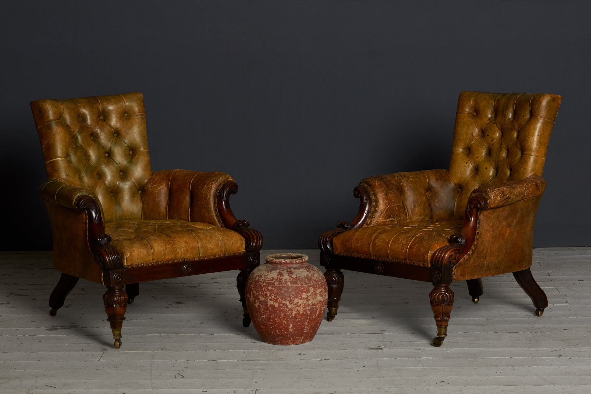 Pair of English 19th Century William IV Leather Covered Arm Chairs