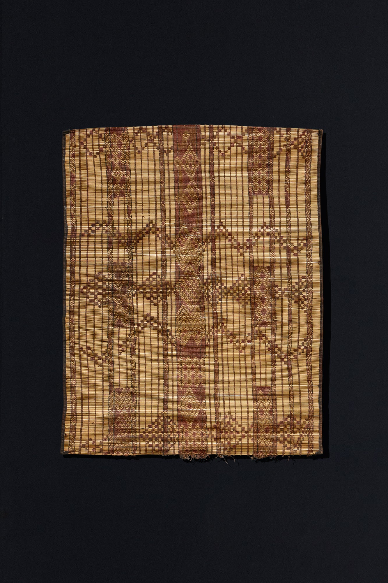 Small Leather and Reed Touareg Mat with Brocade Pattern.............. (3' 3'' x 3' 11'')