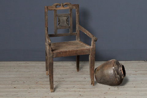 Small Primitive Teak Arm Chair with Crested Back