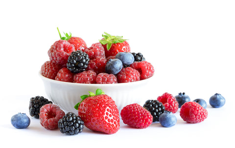 Strawberries, blueberries, blackberries that are sources for resveratrol in a bowl