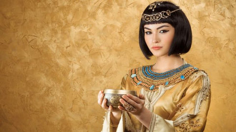 An Egyptian woman holding a bowl with wine for skin beauty