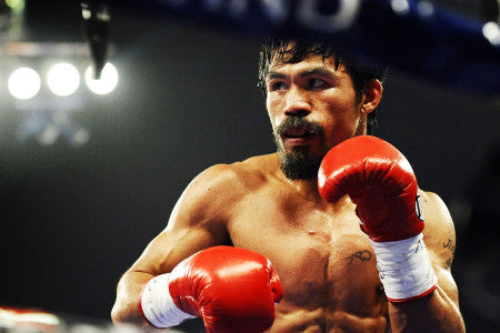 Manny Pacquiao with boxing gloves in the ring