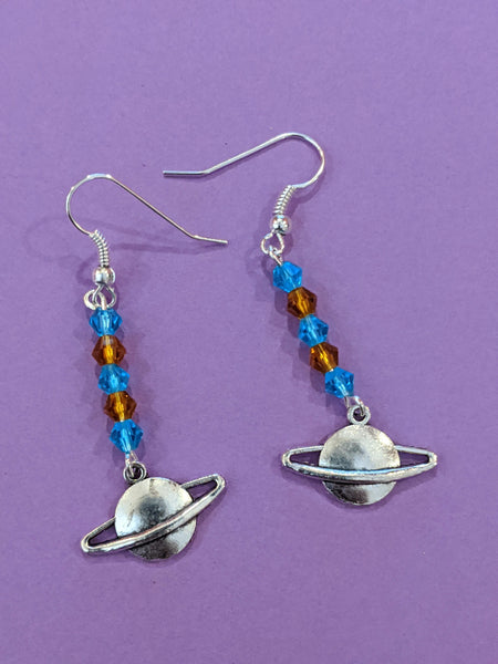 Planetary! Sparkly faceted bicones and silver ringed planet dangle earrings