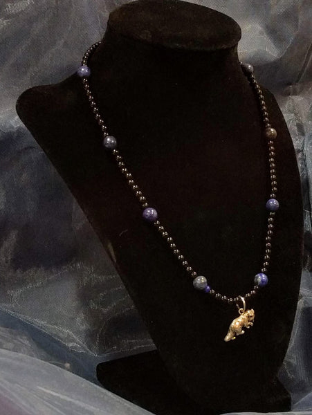 Wolfcub pendant on lapis lazuli and black glass beaded necklace.