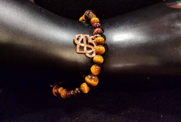 Infinity heart in rose gold on a tigers eye beaded bracelet
