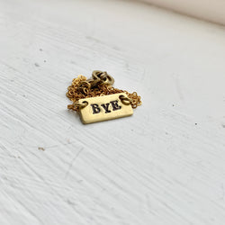 """Bye"" Stamped Necklace"