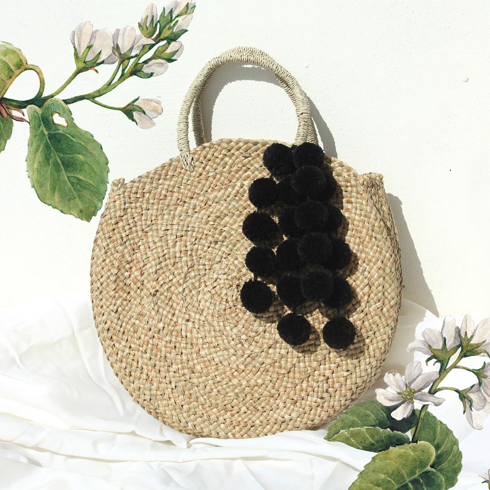 Brunna Luna Bag - Round Straw Tote Bag with Black Tiered Pom-poms