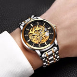 Man wearing Skeleton Silver Black Gold Watch