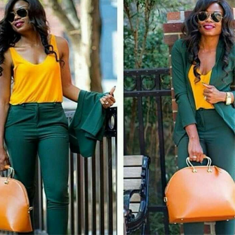 Lady wearing a yellow camisole with emerald green trousers and blazer