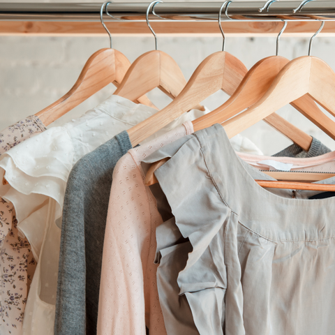 Summer clothing hanging up on wooden hangers