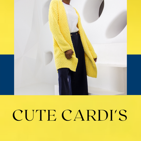 Lady standing in front of a white abstract background wearing a yellow knitted cardigan