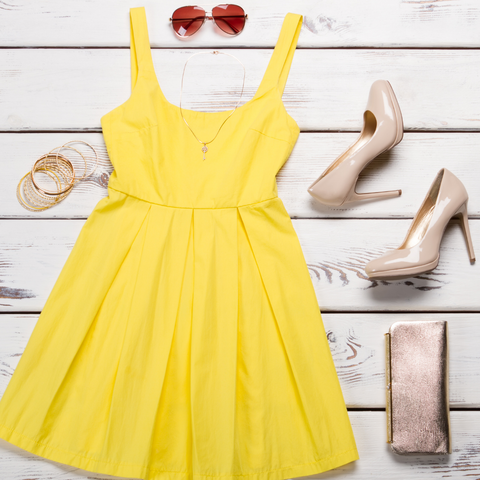 Yellow summer dress, ladies nude high heels and sequin purse