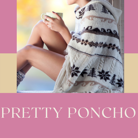 Lady sitting on the floor wearing a knitted poncho
